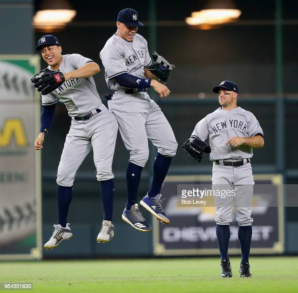 Giancarlo Stanton Aaron Judge and Brett Gardner of the New York Yankees celebrate after a 65 win over the Houston Astros at Minute Maid Park on May 3...
