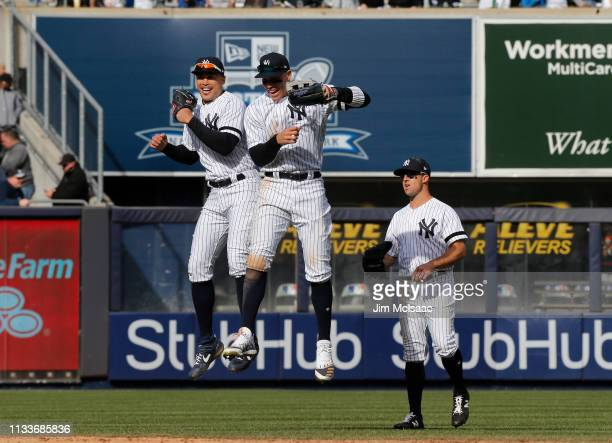 Giancarlo Stanton Aaron Judge and Brett Gardner of the New York Yankees celebrate after defeating the Baltimore Orioles on Opening Day at Yankee...