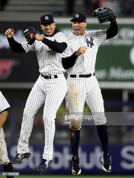 Giancarlo Stanton an Aaron Judge of the New York Yankees celebrate the 114 win over the Tampa Bay Rays during Opening Day at Yankee Stadium on April...