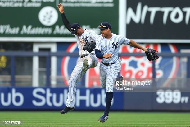 Giancarlo Stanton and Aaron Hicks of the New York Yankees celebrate after defeating the Kansas City Royals 63 at Yankee Stadium on July 29 2018 in...