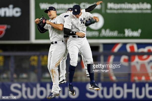 Giancarlo Stanton and Aaron Judge of the New York Yankees celebrate after defeating the Houston Astros at Yankee Stadium on May 30 2018 in the Bronx...