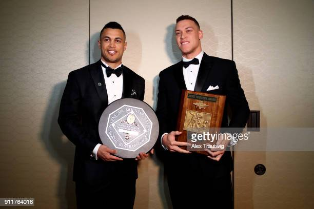 Giancarlo Stanton and Aaron Judge of the New York Yankees pose for a photo during the 2018 Baseball Writers' Association of America awards dinner on...