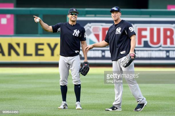 Giancarlo Stanton and Aaron Judge of the New York Yankees warm up before the game against the Washington Nationals at Nationals Park on May 15 2018...