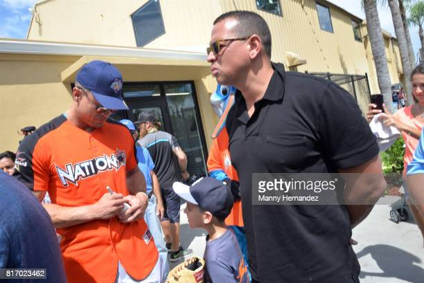 Giancarlo Stanton and Alex Rodriguez at the MLB All Star Week Miami Ribbon Cutting at the Boys and Girls Club in Kendall on July 11 2017 in Miami...