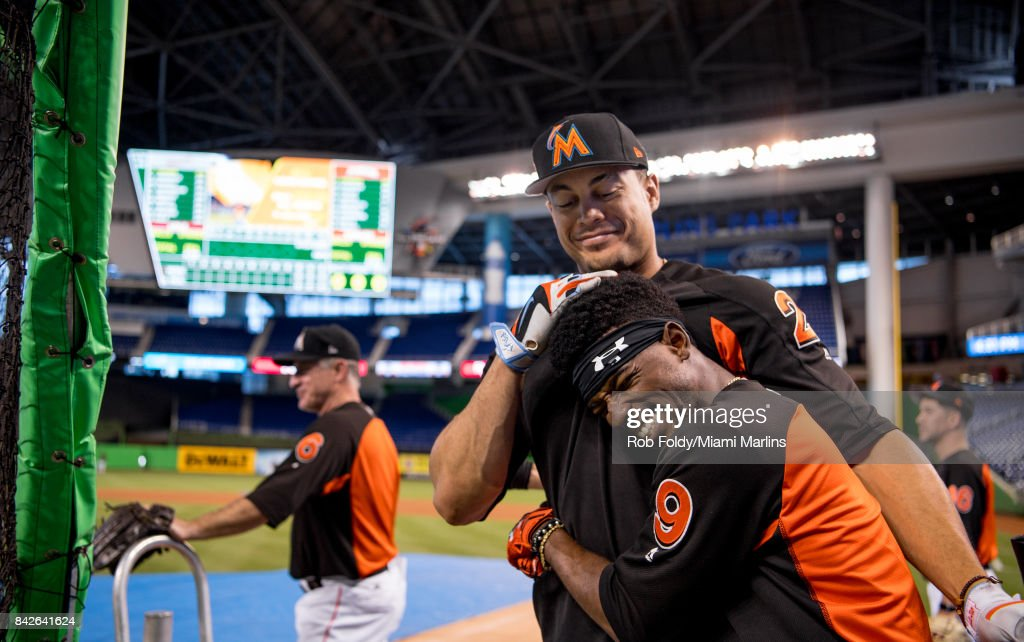 Giancarlo Stanton #27 and Dee Gordon #9 of the Miami Marlins at batting practice before the game against the Washington Nationals at Marlins Park on September 4, 2017 in Miami, Florida.