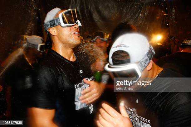 Giancarlo Stanton and Gary Sanchez of the New York Yankees celebrates clinching a playoff spot after defeating the Baltimore Orioles 32 in eleventh...