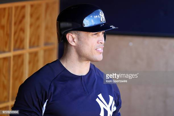 Giancarlo Stanton looks out towards the field before moving to the batting cage during the New York Yankees spring training workout on February 19 at...