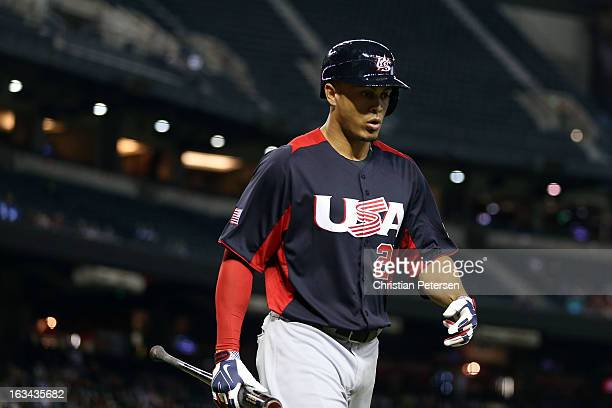 Giancarlo Stanton of Team USA walks back to the dugout after striking out in the fourth inning against Team Italy during the World Baseball Classic...