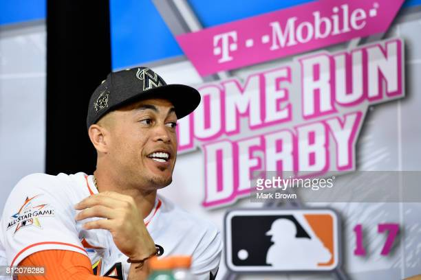 Giancarlo Stanton of the Miami Marlins and the National League speaks with the media during Gatorade All-Star Workout Day ahead of the 88th MLB...