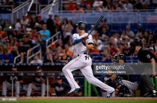 Giancarlo Stanton of the Miami Marlins at bat during the game against the Atlanta Braves at Marlins Park on October 1 2017 in Miami Florida