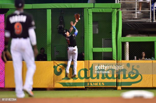 Giancarlo Stanton of the Miami Marlins attempts to catch a fly ball in right field in the sixth inning against the Los Angeles Dodgers at Marlins...