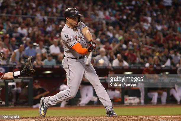 Giancarlo Stanton of the Miami Marlins bats against the Arizona Diamondbacks during the MLB game at Chase Field on September 24 2017 in Phoenix...