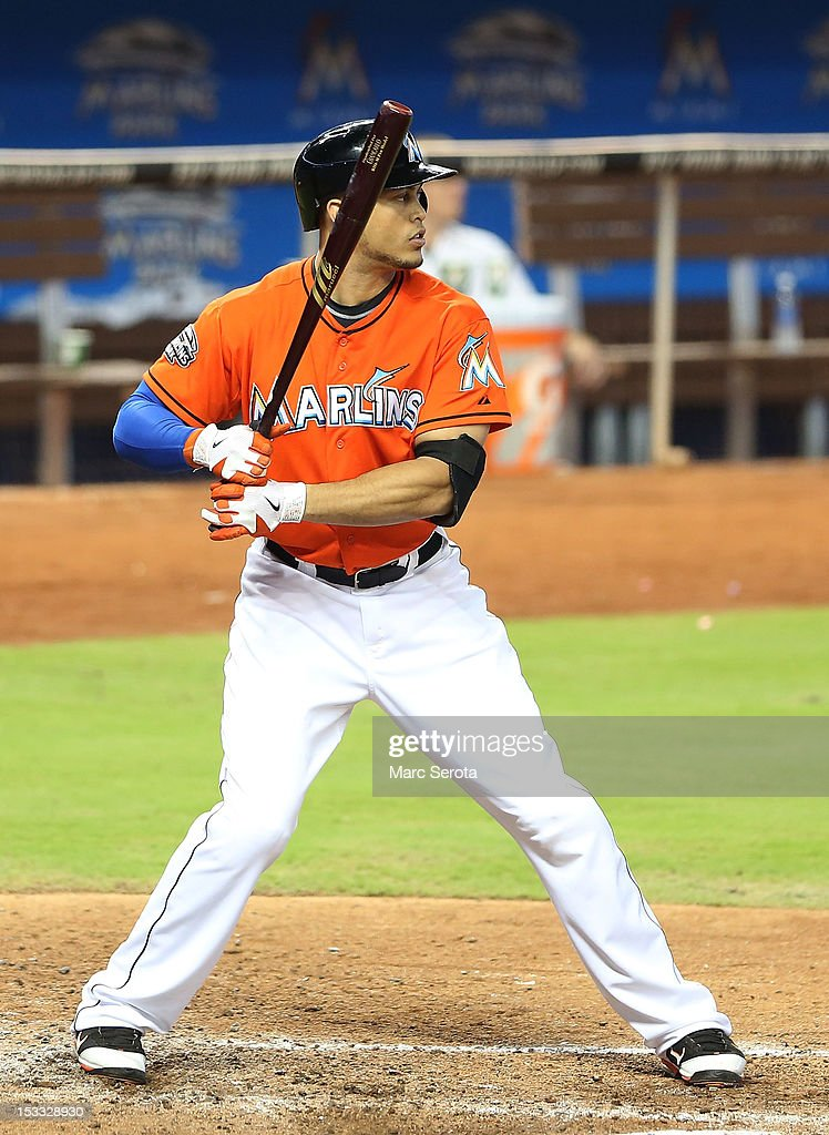 Giancarlo Stanton #27 of the Miami Marlins bats against the New York Mets at Marlins Park on October 3, 2012 in Miami, Florida. The Mets defeated the Marlins 4-2.