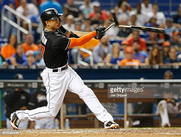 Giancarlo Stanton of the Miami Marlins breaks his bat as he flies out in the sixth inning of play against the Atlanta Braves at Marlins Park on...