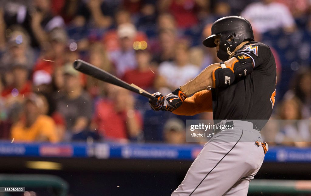 Giancarlo Stanton #27 of the Miami Marlins breaks his bat in the top of the fourth inning against the Philadelphia Phillies at Citizens Bank Park on August 23, 2017 in Philadelphia, Pennsylvania. The Phillies defeated the Marlins 8-0.