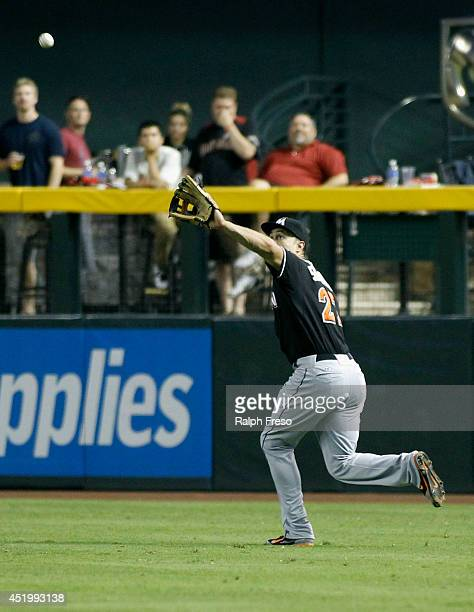 Giancarlo Stanton of the Miami Marlins catches a deep fly ball during the sixth inning of a MLB game against the Arizona Diamondbacks at Chase Field...