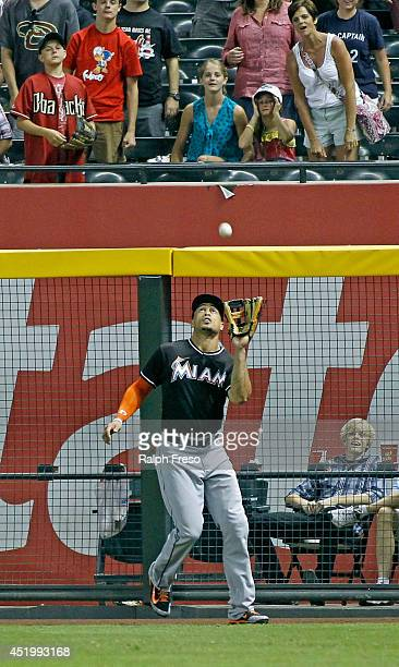 Giancarlo Stanton of the Miami Marlins catches a deep fly ball during the ninth inning of a MLB game against the Arizona Diamondbacks at Chase Field...