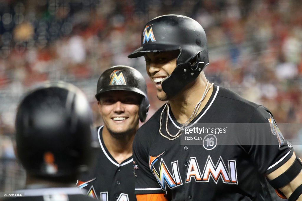 Giancarlo Stanton #27 of the Miami Marlins celebrates after hitting a three run home run against the Washington Nationals in the fifth inning at Nationals Park on August 8, 2017 in Washington, DC.