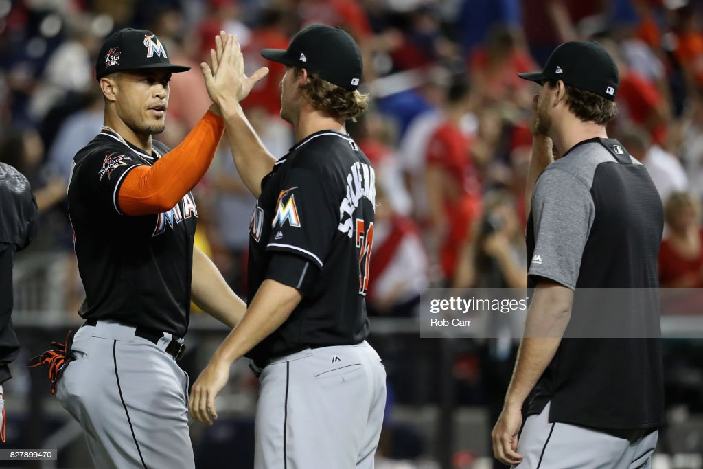 Giancarlo Stanton #27 of the Miami Marlins celebrates with Drew Steckenrider #71 after the Marlins defeated the Washington Nationals 7-3 at Nationals Park on August 8, 2017 in Washington, DC.