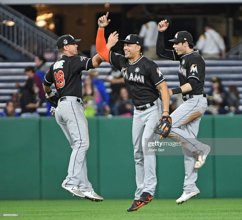 Giancarlo Stanton #27 of the Miami Marlins celebrates with Tyler Moore #28 and Christian Yelich #21 after the final out in the Miami Marlins 7-1 win over the Pittsburgh Pirates at PNC Park on June 8, 2017 in Pittsburgh, Pennsylvania.