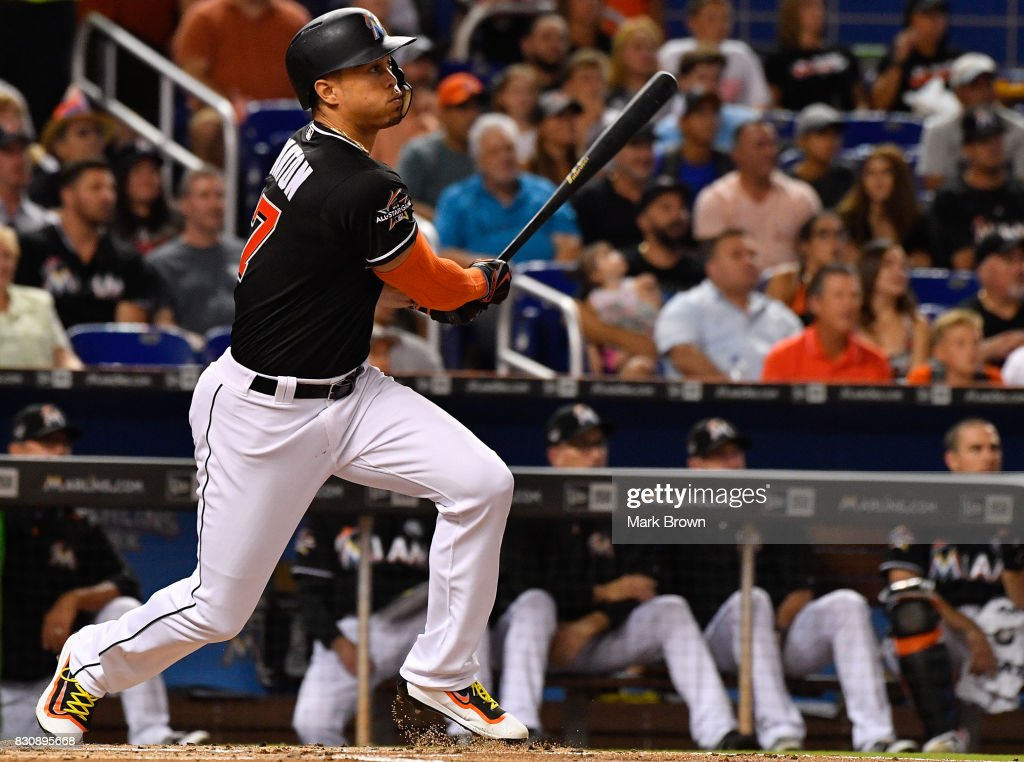 Giancarlo Stanton #27 of the Miami Marlins doubles in the first inning during the game between the Miami Marlins and the Colorado Rockies at Marlins Park on August 12, 2017 in Miami, Florida.