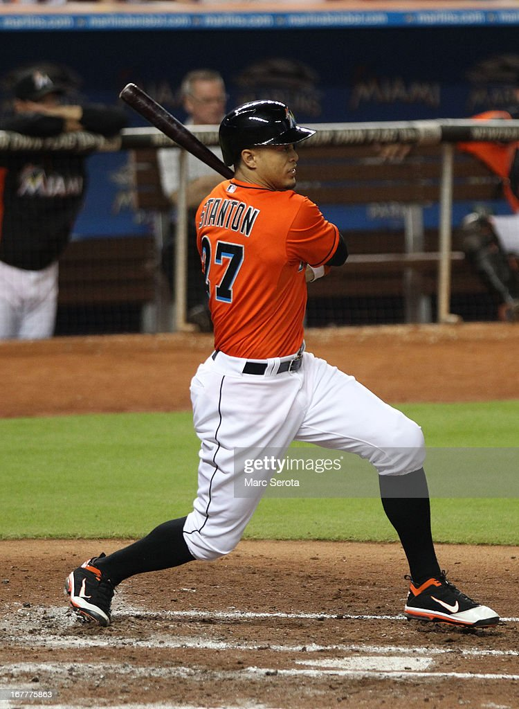 Giancarlo Stanton #27 of the Miami Marlins drives in a run against the New York Mets in the third inning at Marlins Park on April 29, 2013 in Miami, Florida.