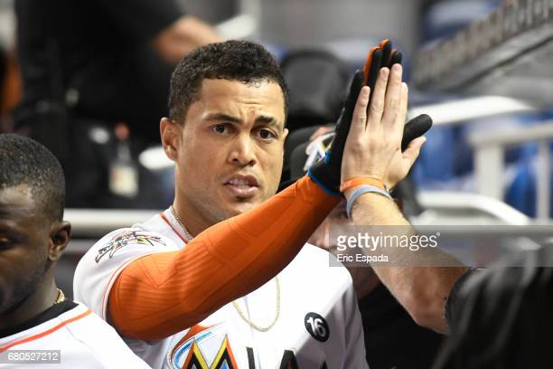 Giancarlo Stanton of the Miami Marlins high fives his teammates after hitting a homer in the ninth inning against the St Louis Cardinals at Marlins...