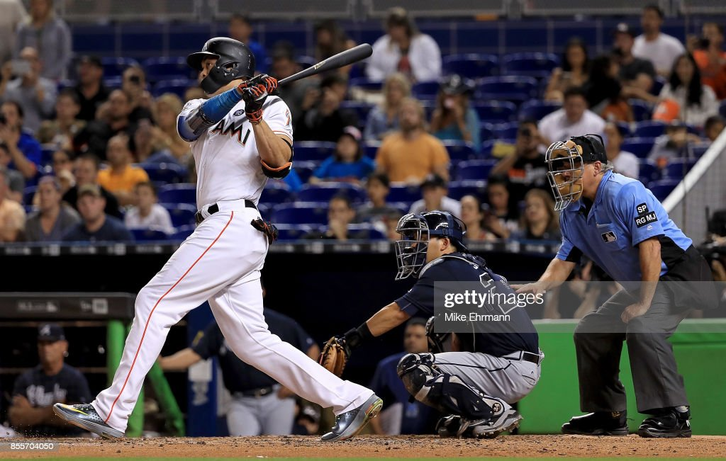 Giancarlo Stanton #27 of the Miami Marlins hits a double in the sixth inning during a game against the Atlanta Braves at Marlins Park on September 29, 2017 in Miami, Florida.