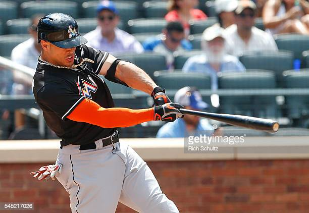 Giancarlo Stanton of the Miami Marlins hits a home run against the New York Mets in the sixth inning during a game against the New York Mets at Citi...