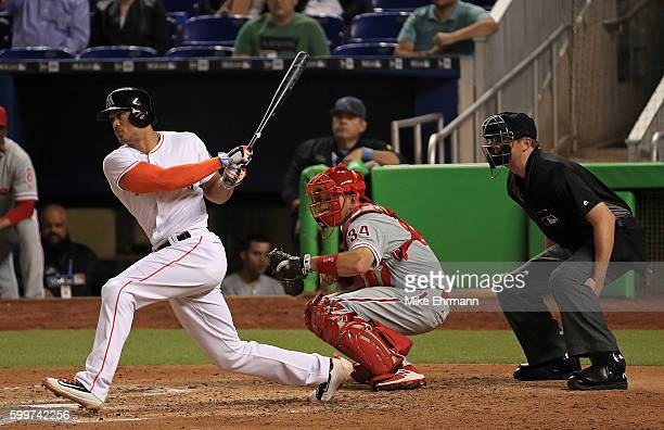 Giancarlo Stanton of the Miami Marlins hits a pinch hit single in the fifth inning during a game against the Philadelphia Phillies at Marlins Park on...