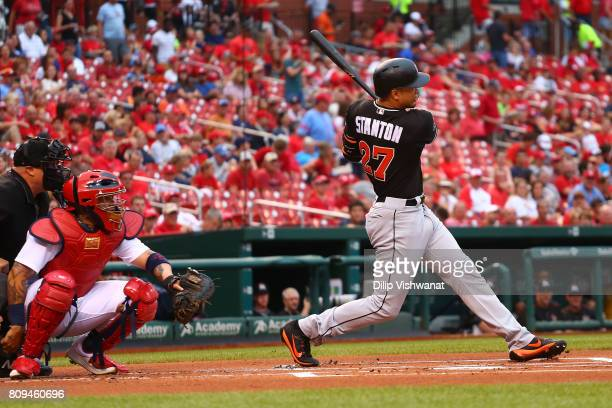 Giancarlo Stanton of the Miami Marlins hits a solo home run against the St Louis Cardinals in the first inning at Busch Stadium on July 5 2017 in St...