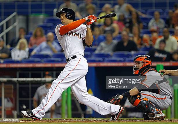 Giancarlo Stanton of the Miami Marlins hits a solo home run during a game against the San Francisco Giants at Marlins Park on May 24 2012 in Miami...