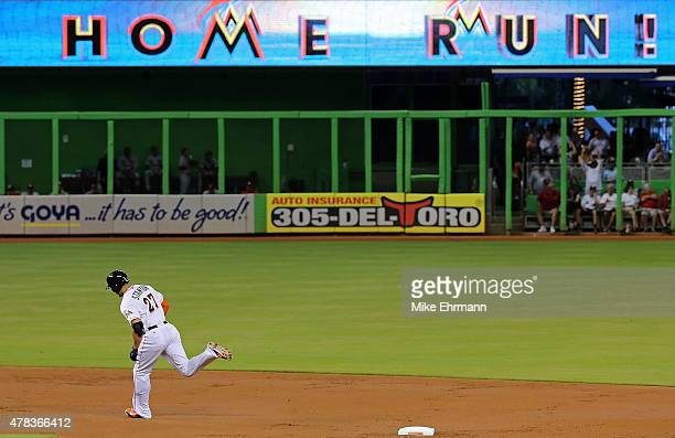 Giancarlo Stanton of the Miami Marlins hits a solo home run during a game against the St Louis Cardinals at Marlins Park on June 24 2015 in Miami...