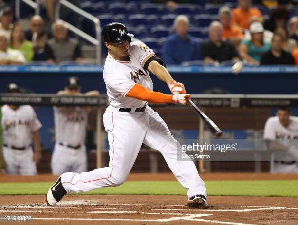 Giancarlo Stanton of the Miami Marlins hits a solo home run in the seventh inning against the San Diego Padres at Marlins Park on June 29 2013 in...