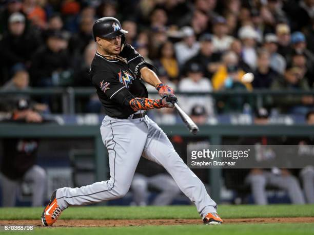Giancarlo Stanton of the Miami Marlins hits a solo home run off of starting pitcher Felix Hernandez of the Seattle Mariners during the third inning...