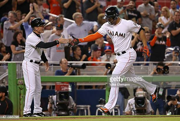 Giancarlo Stanton of the Miami Marlins hits a two run home run during a game against the New York Mets at Marlins Park on April 29 2015 in Miami...