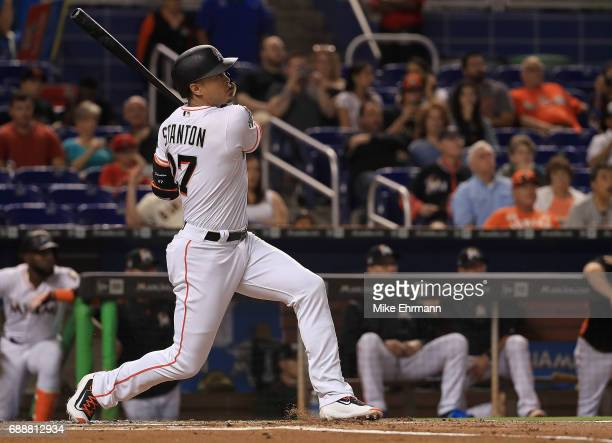 Giancarlo Stanton of the Miami Marlins hits a two run home run in the first inning during a game against the Los Angeles Angels at Marlins Park on...