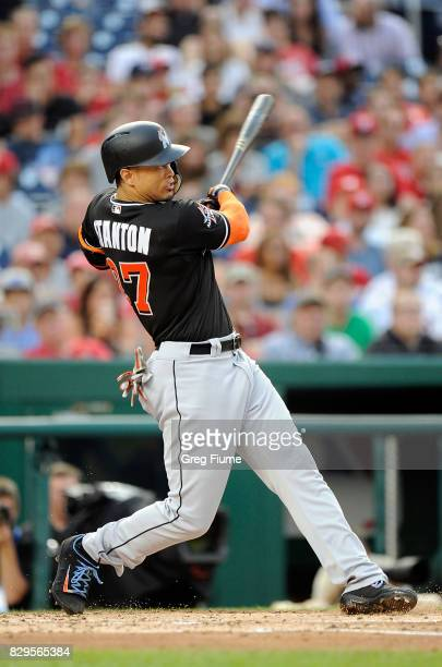 Giancarlo Stanton of the Miami Marlins hits a tworun home run in the third inning against the Washington Nationals at Nationals Park on August 10...