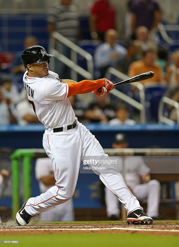 Giancarlo Stanton #27 of the Miami Marlins hits during a game against the Chicago Cubs at Marlins Park on April 25, 2013 in Miami, Florida.