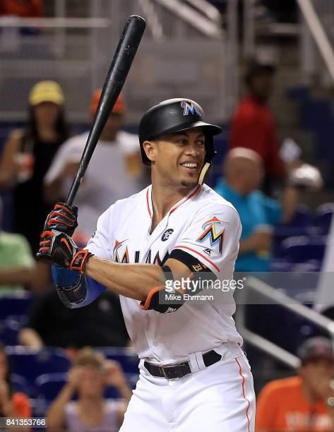 Giancarlo Stanton of the Miami Marlins hits during a game against the Philadelphia Phillies at Marlins Park on August 31 2017 in Miami Florida