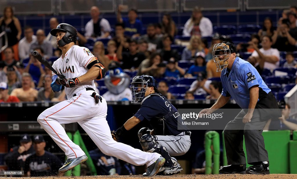 Giancarlo Stanton #27 of the Miami Marlins hits during a game against the Atlanta Braves at Marlins Park on September 29, 2017 in Miami, Florida.