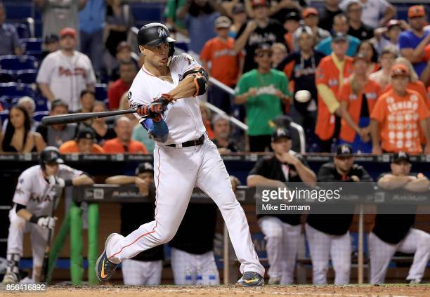 Giancarlo Stanton of the Miami Marlins hits during a game against the Atlanta Braves at Marlins Park on October 1 2017 in Miami Florida