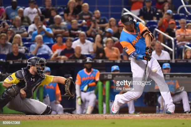Giancarlo Stanton of the Miami Marlins hits his 50th home run of the season in the eighth inning against the San Diego Padres at Marlins Park on...