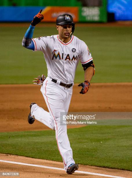 Giancarlo Stanton of the Miami Marlins hits his 53rd home run of the season during the fifth inning of the game against the Washington Nationals at...