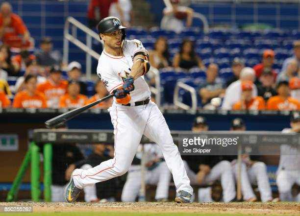 Giancarlo Stanton of the Miami Marlins hits his 56th home run of the season in the eighth inning against the New York Mets at Marlins Park on...