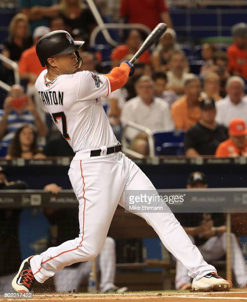 Giancarlo Stanton of the Miami Marlins hits in the first inning during a game against the New York Mets at Marlins Park on June 27 2017 in Miami...