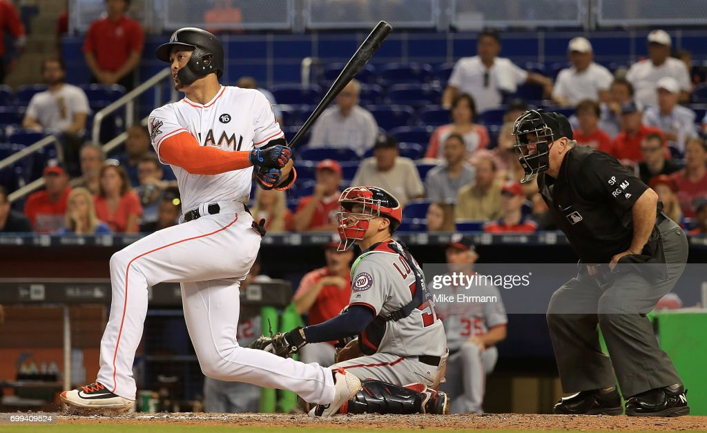 Giancarlo Stanton #27 of the Miami Marlins hits the go ahead run on an RBI single in the eighth inning a game against the Washington Nationals at Marlins Park on June 21, 2017 in Miami, Florida.