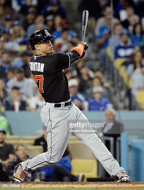 Giancarlo Stanton of the Miami Marlins hits three-run home run off pitcher Clayton Kershaw of the Los Angeles Dodgers during the sixth inning of a...