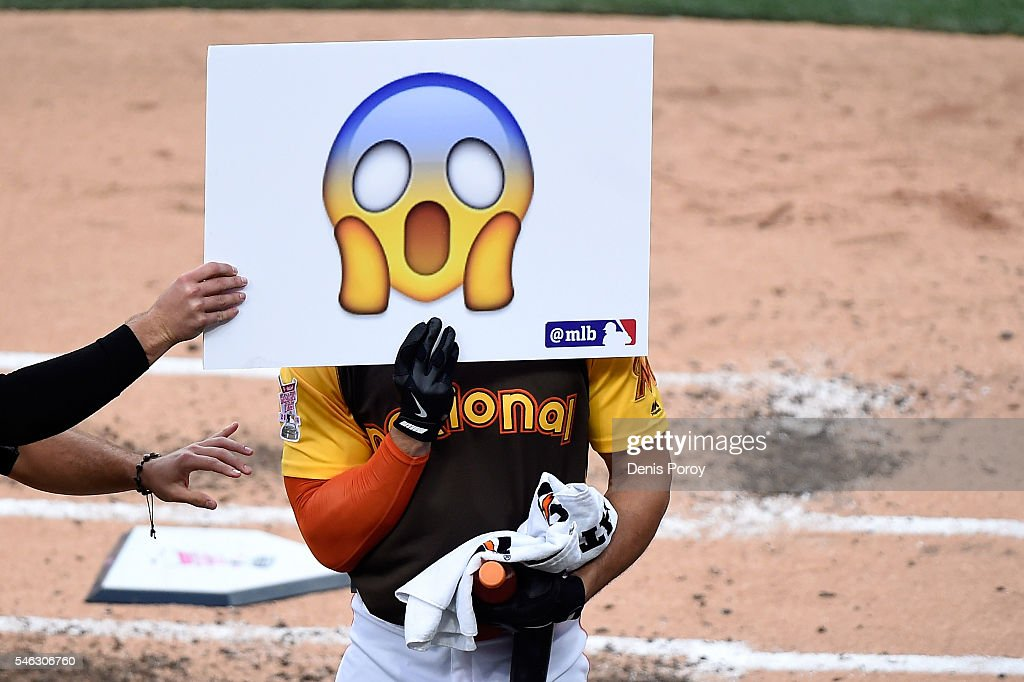 Giancarlo Stanton of the Miami Marlins holds a sign up during the T-Mobile Home Run Derby at PETCO Park on July 11, 2016 in San Diego, California.