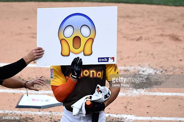 Giancarlo Stanton of the Miami Marlins holds a sign up during the TMobile Home Run Derby at PETCO Park on July 11 2016 in San Diego California